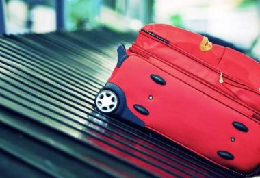 Baggage on conveyor belt at the airport - selective focus